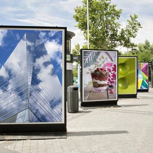 backlit –backlit film and printable film from Midcomp. Picture of brightly coloured posters in light boxes.